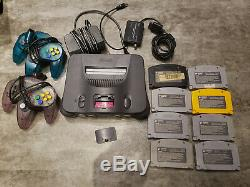 N64 Console, 2 Controllers, Power, Adapter RF Switch/RF Modulator Cable, 8 Games